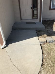 sunken sidewalk before mudjacking in Olathe, KS